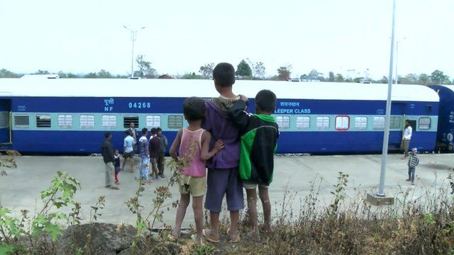 Local children watch new train