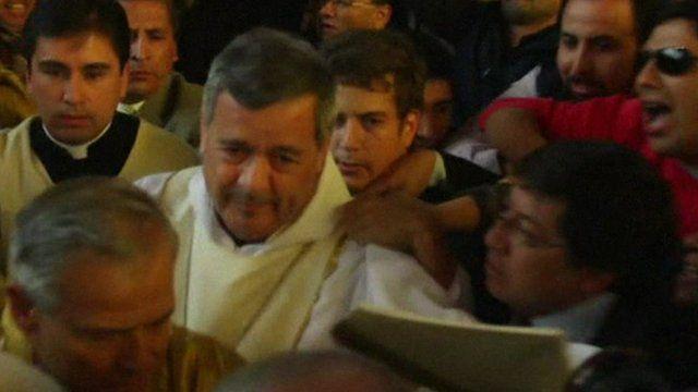 Protesters surround bishop