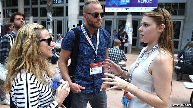 Delegates talking to each other at South-by-Southwest (SXSW)