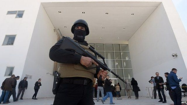 Tunisian security forces stand guard outside the Bardo Museum in Tunis. 19 March 2015
