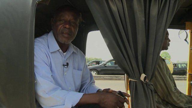 Abdulahi Kaura Abubakar in a vehicle about to cross the bridge over the Kaduna river in Nigeria
