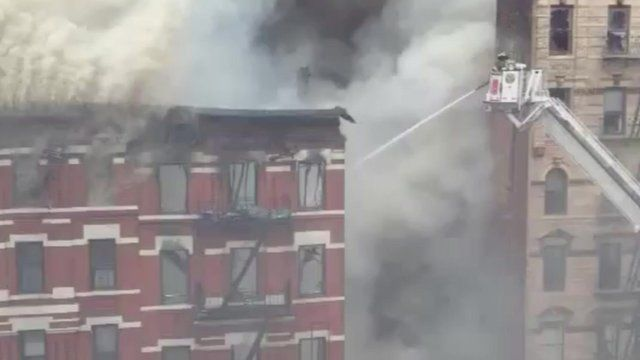 Pouring water on the burning building