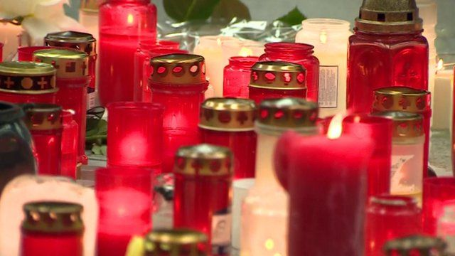 Red and white candles at a memorial at Dusseldorf airport to victims of Germanwings crash