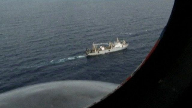 View of fishing boat in search for trawler, viewed from rescue plane