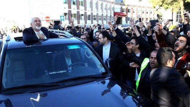 Iranian Foreign Minister Mohammad Javad Zarif pays respect to his well wishers upon arrival at in Tehran