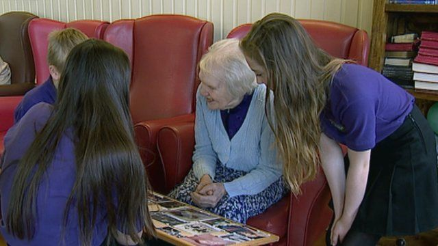 School pupils visit a resident in a care home