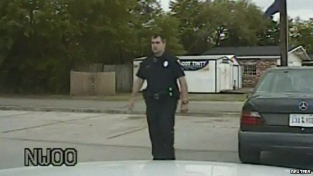 Police officer Michael Slager walking away from Walter Scott's car after pulling him over