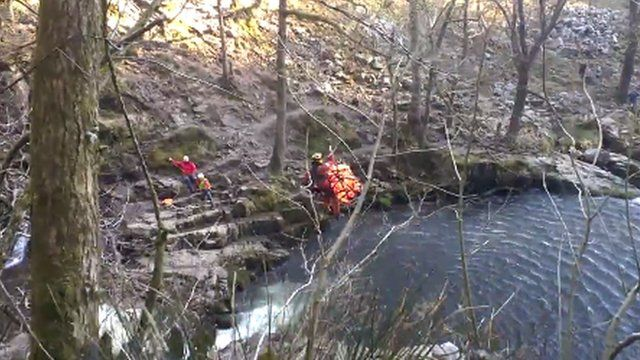 RAF and mountain rescue teams winch a man from a Brecon Beacons gorge