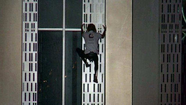 Alain Robert climbing Dubai's Cayan Tower
