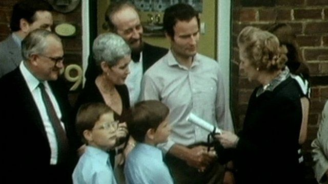 Margaret Thatcher hands over deeds to one of the first council houses bought under the 'Right To Buy' scheme