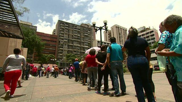 People queuing in Caracas for groceries