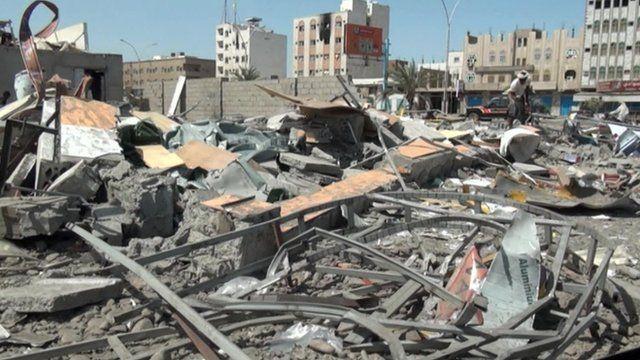 Damaged buildings and debris in Aden, Yemen following Saudi air strikes