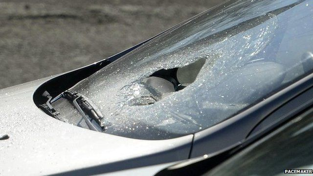 A car belonging to a member of the public had its windscreen smashed in the incident