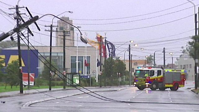 Overturned power lines and a fire engine