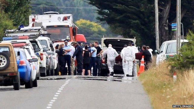 The bodies of one of the crash victims is removed from the accident site by the Police on January 7, 2012 in Carterton, New Zealand