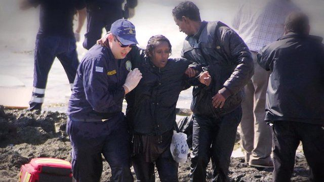 Migrant woman being rescued