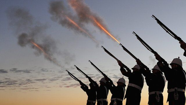Members of the Albert Battery shoot a volley of fire during the Anzac Day dawn service at Currumbin Surf Life Saving Club, Queensland