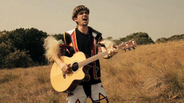 'White Zulu' Qadasi who's real name is David Jenkins, playing the guitar