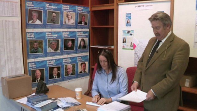 Councillor John Lynch of Eden District Council in office (with another member of staff)