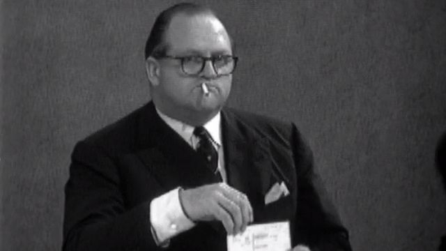 Richard Dimbleby unwinds with a cigarette during the BBC's election night coverage in 1964 - 15 October 1964