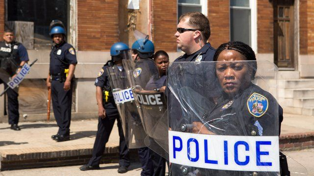 Police with shields in Baltimore