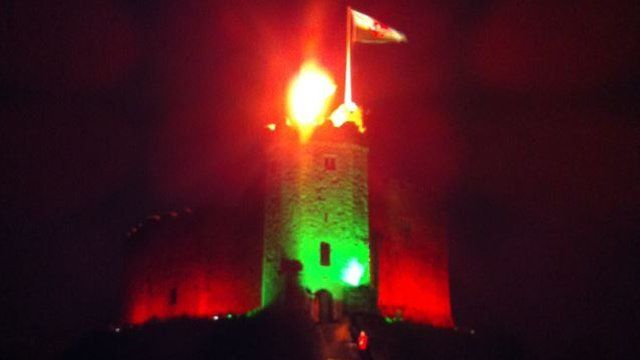 The lit beacon at Cardiff Castle