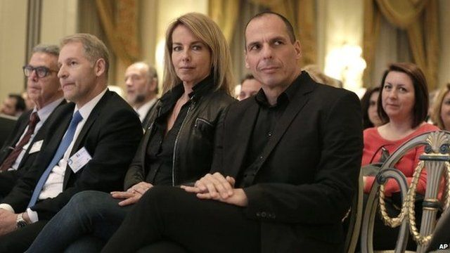 Greek Finance Minister Yanis Varoufakis, right, attends with his wife his wife Danae Stratou a banking conference in Athens, Tuesday, April 21, 2015.