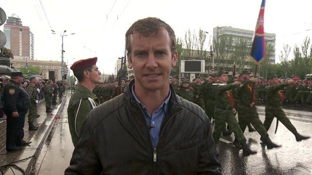 BBC reporter Tom Burridge at a Victory Day parade organised by pro-Russian rebels in the Ukrainian city of Donetsk