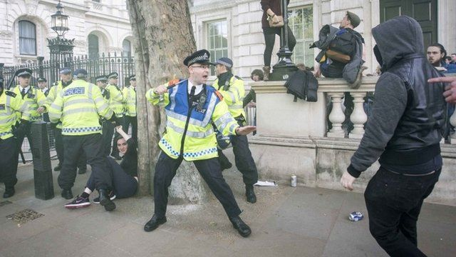 Police and protesters outside Downing Street