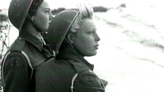 Women look out over UK beach