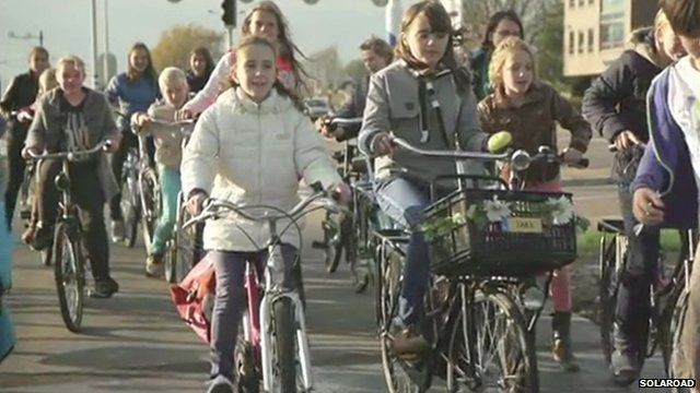 Cyclists on a solar road