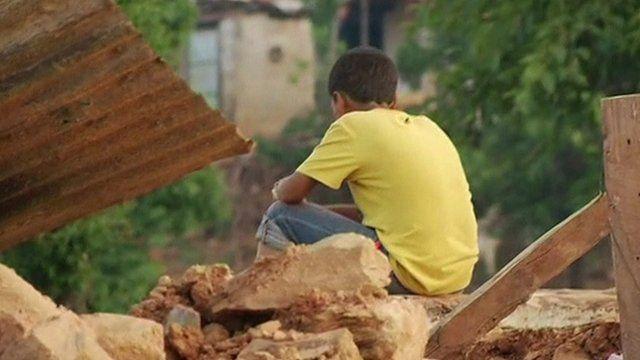 Boy sitting on rubble