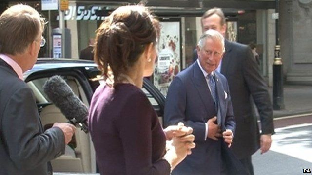 Kristina Kyriacou (centre) just before she rips the cover off the microphone of Channel 4 News journalist Michael Crick (left)