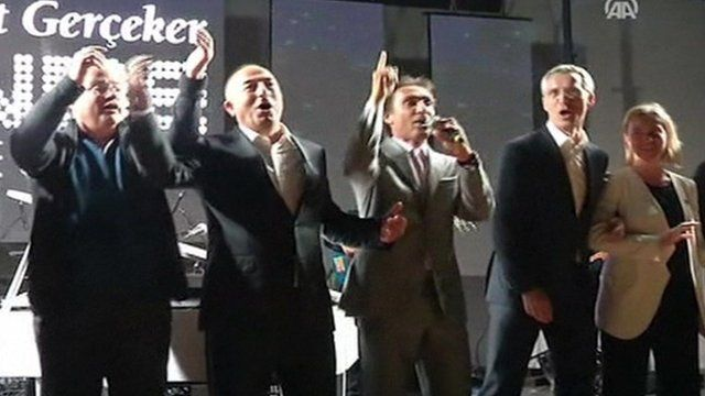 Officials joining in the singing include from left; Greek FM Nikos Kotzias, Turkish FM Mevlut Cavusoglu, Nato Secretary-General Jens Stoltenberg and EU Foreign Policy Chief Federica Mogherini