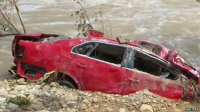 Damaged car in Texas floodwaters