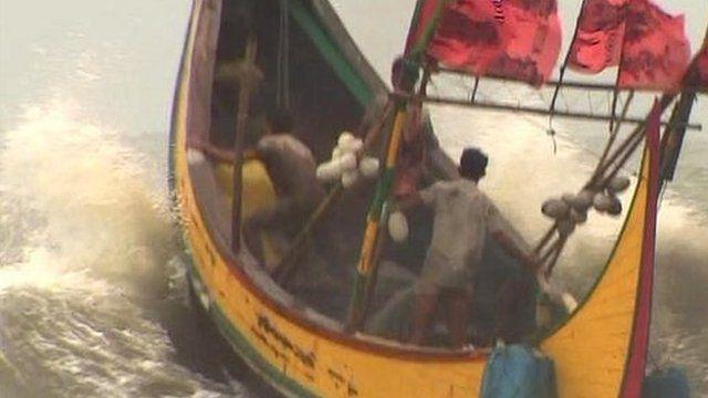 Small boat at sea off the coast of southern Bangladesh