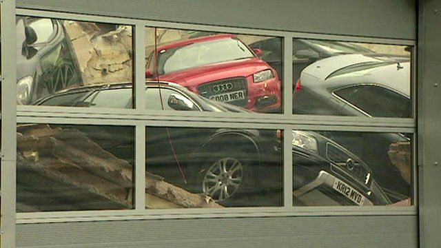 Some of the cars which fell through the car showroom roof