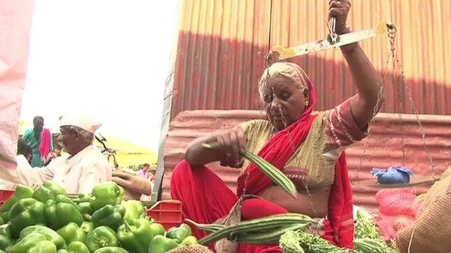 Woman weighing vegetables