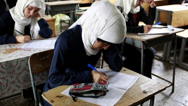 Girls in Yemen classroom take an exam in image taken in 2016