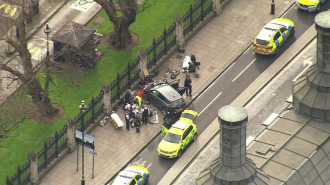 Ambulance crews and police outside the Palace of Westminster