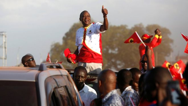 President Uhuru Kenyatta gestures to supporters as he leaves the last Jubilee Party campaign rally ahead of the August 8th election in Nakuru, Kenya