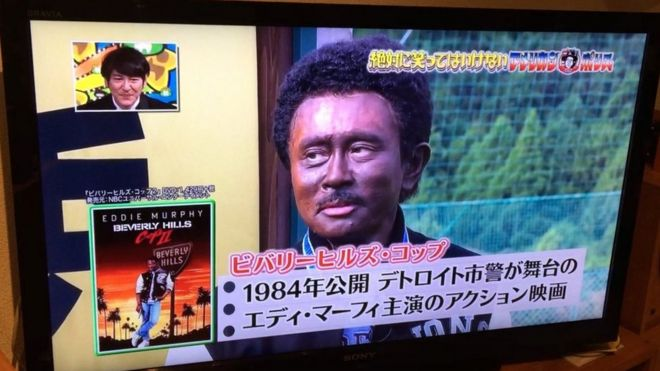 Japanese comedian with his face painted black