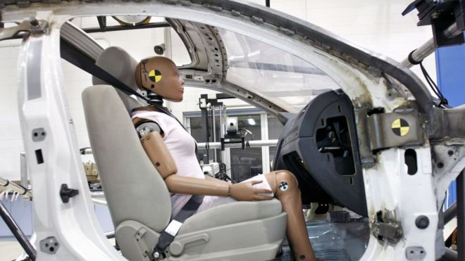 A crash-test dummy sits in a testing sled at Takata's current crash-testing facility in Michigan (2010)