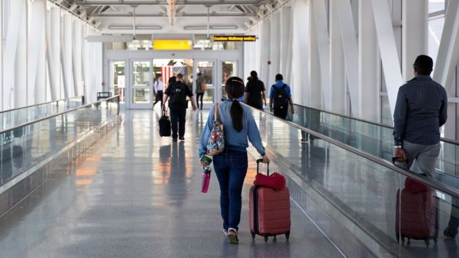 People head towards departures at John F Kennedy Airport in 2016