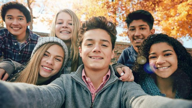 Group of adolescents posing for a selfie