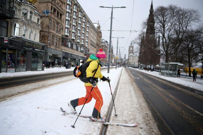 A person skis along Princes Street in Edinburgh