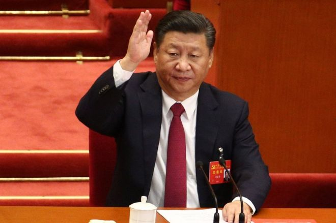 Chinese President and General Secretary of the Communist Party of China Xi Jinping raises hand to take a vote during the closing ceremony of the 19th National Congress of the Communist Party of China (CPC) at the Great Hall of the People (GHOP) in Beijing, China, 24 October 2017.