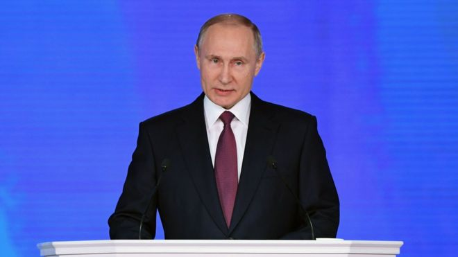 Putin boasts of new weapons, vows to slash poverty