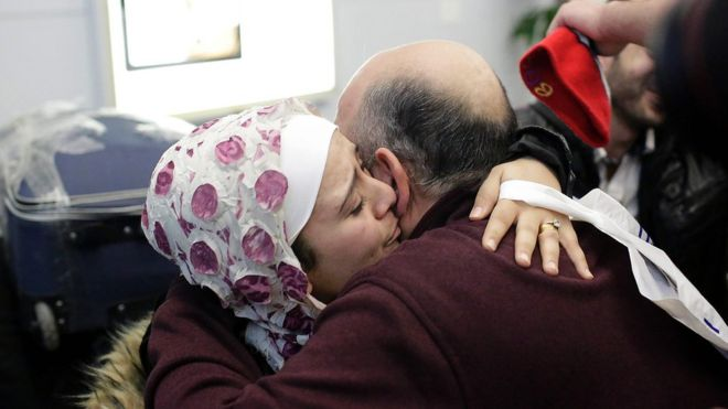 Syrian refugee Baraa Haj Khalaf (left), hugs her father Khaled Haj Khalaf as she arrives at O'Hare International Airport in Chicago, 7 February 2017