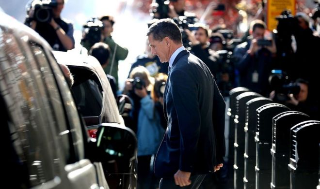 Michael Flynn emerges from a plea hearing in a Washington DC courtroom